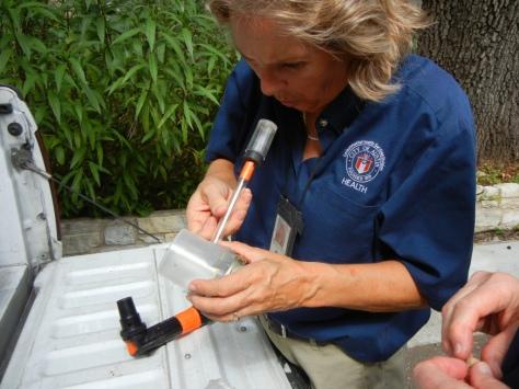 Betty Jones captures mosquitoes in Austin on June 5, 2000.